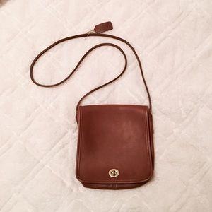 Coach brown cross body purse